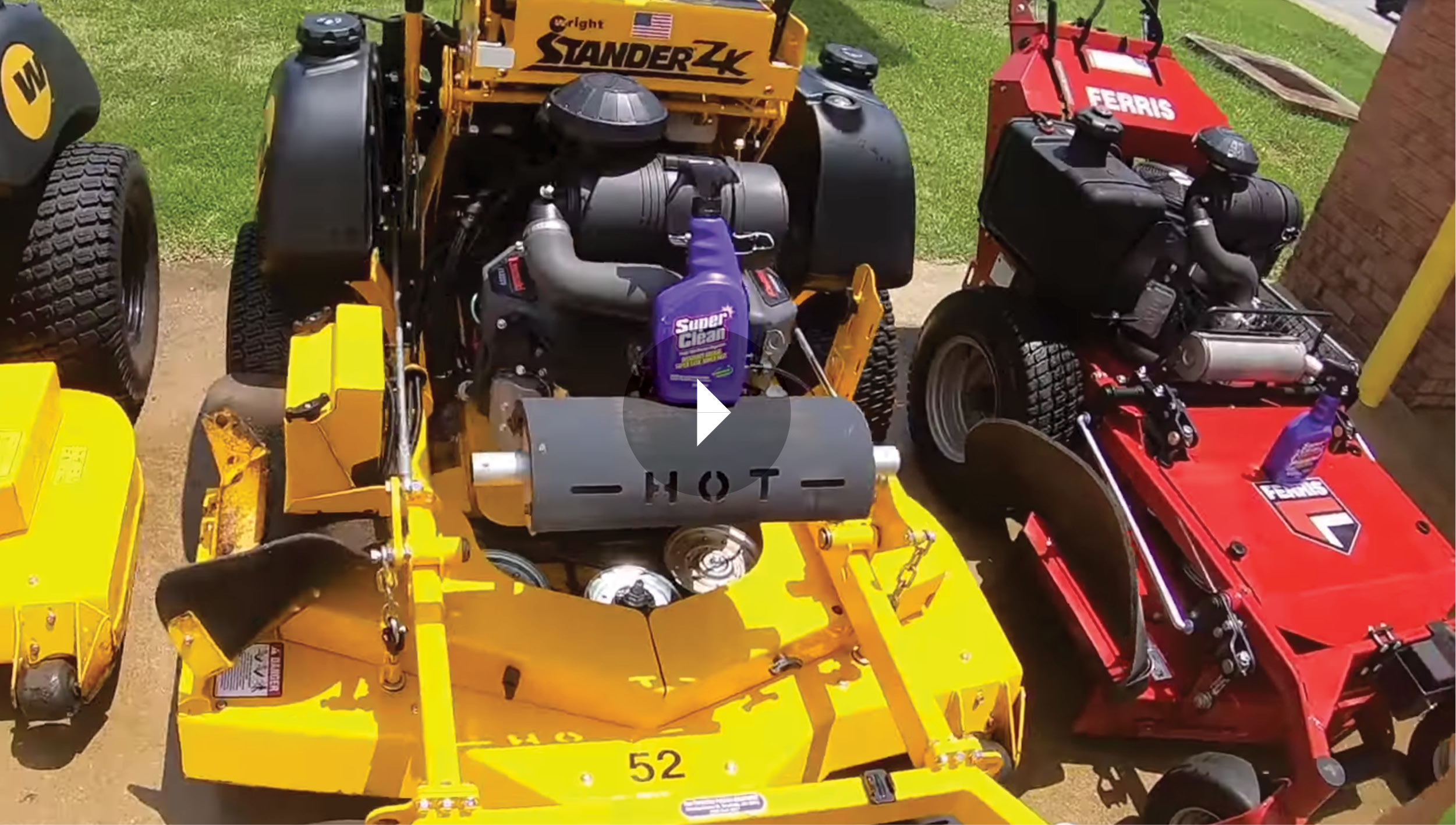 Still frame of stand-on mower with bottle of super clean