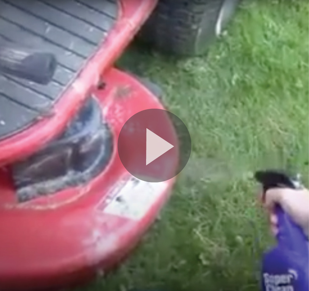 Still frame of red mower cleaned with super clean and play button