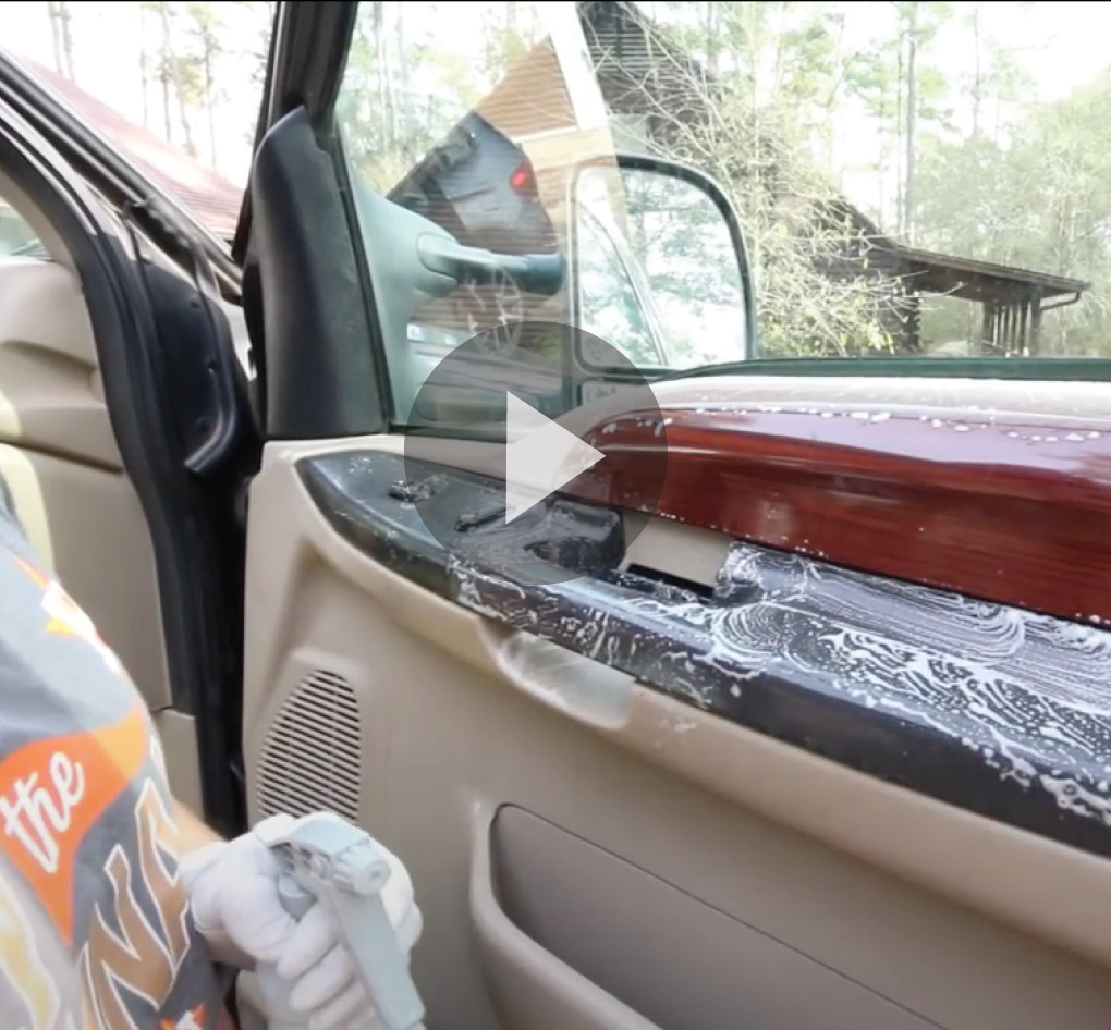 Video still of interior panel of car door being cleaned