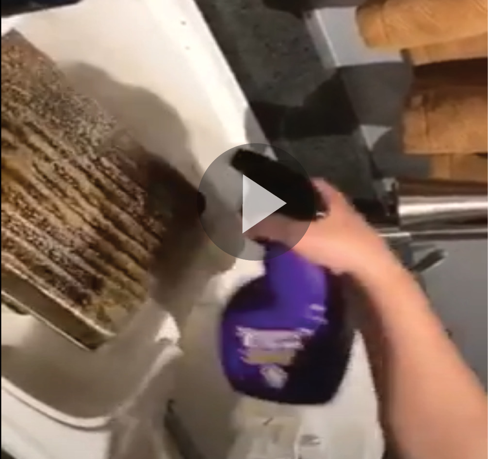 Still shot of video of baking dish cleaned with Super Clean