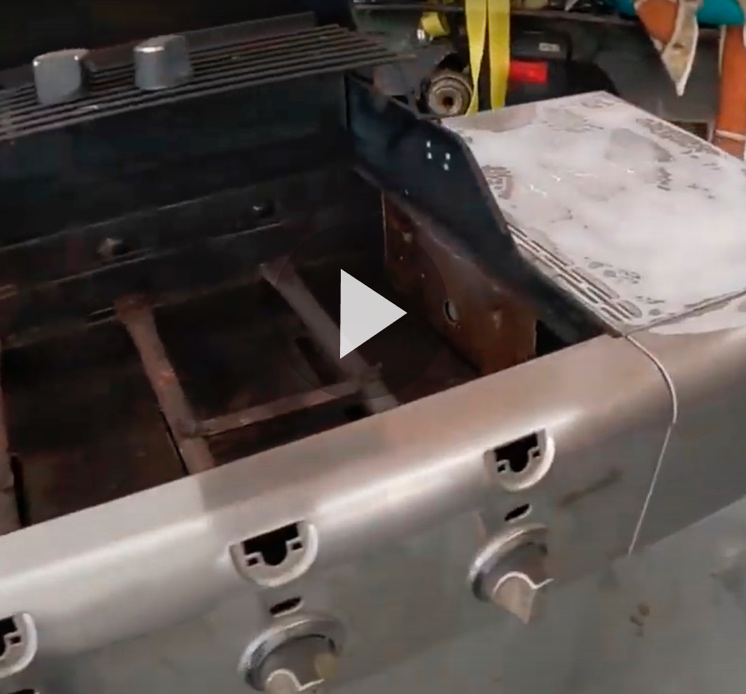 Still frame of video of old propane grill