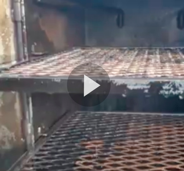 Still frame of smoker racks with Super Clean applied