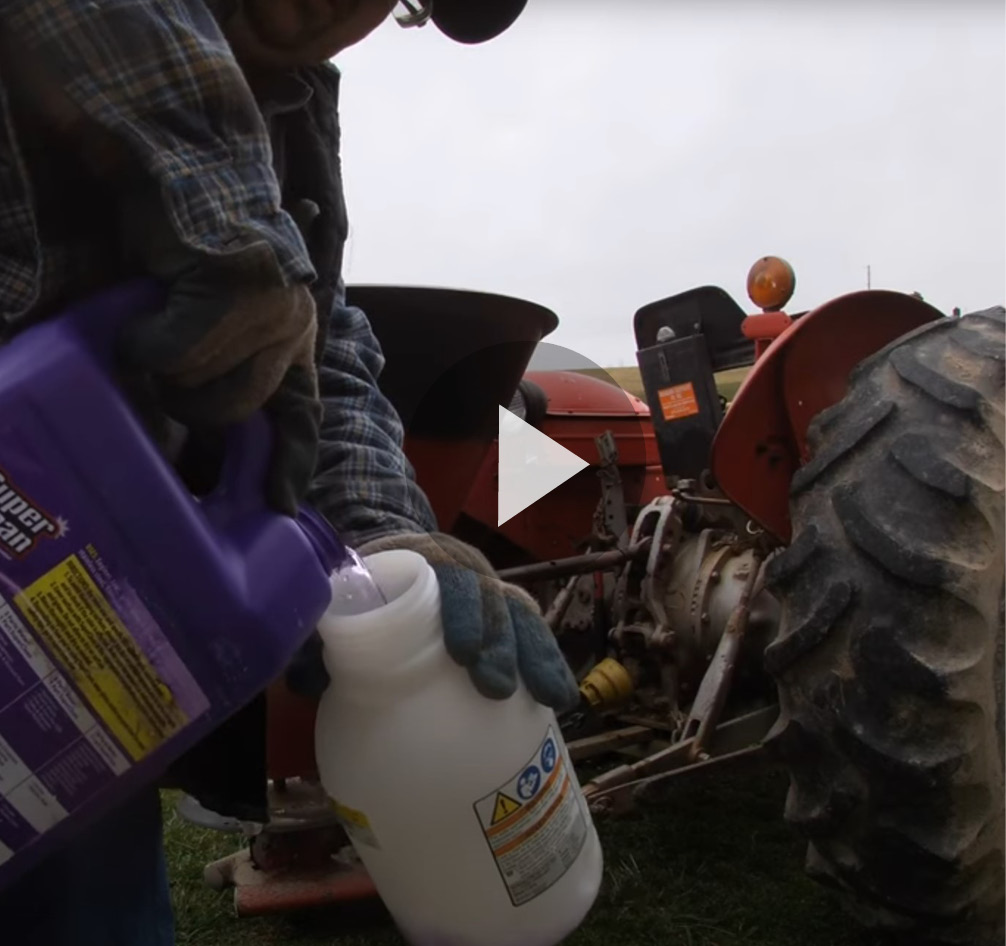Still Frame of video cleaning a fertilizer spreader with Super Clean