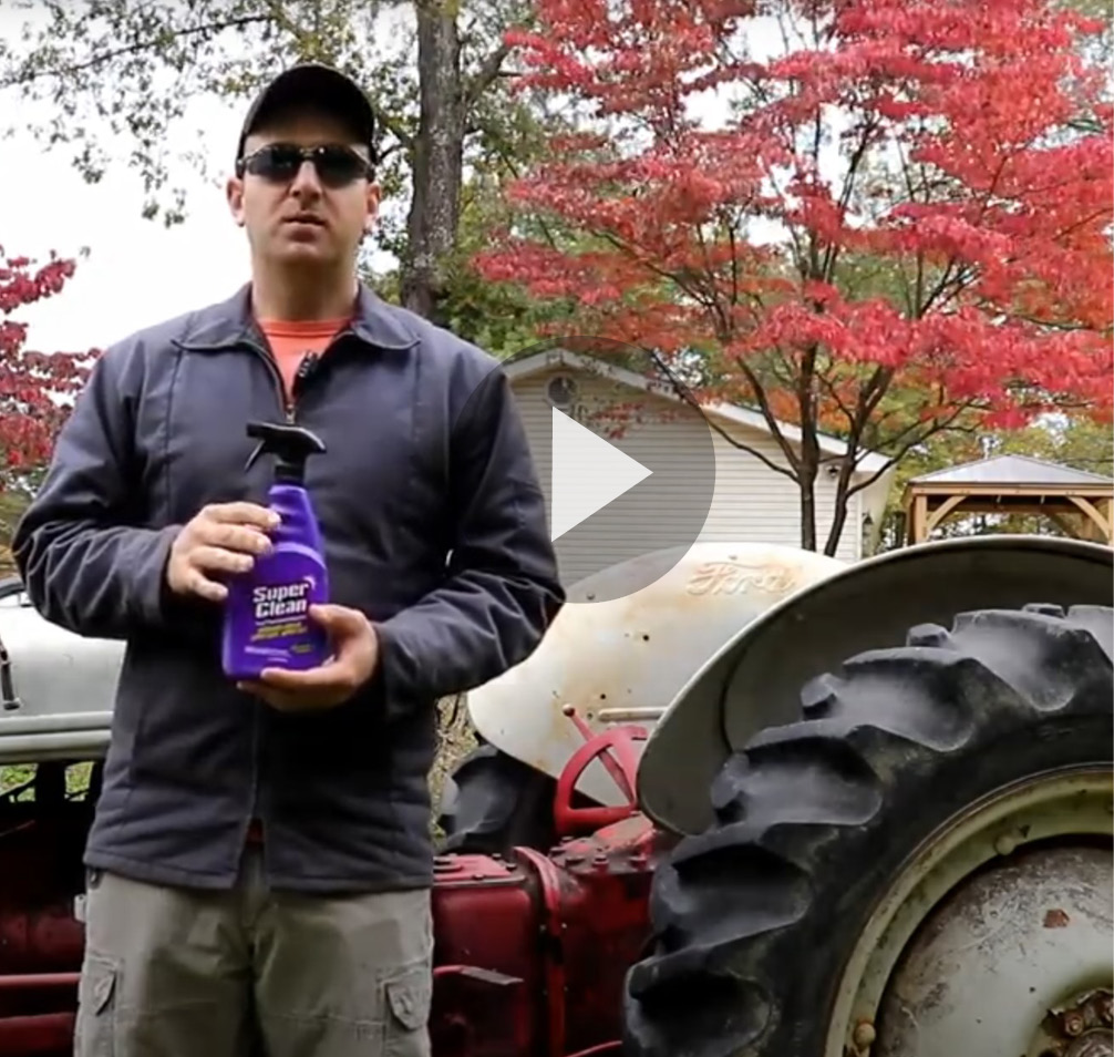 still frame of video cleaning tractor with super clean